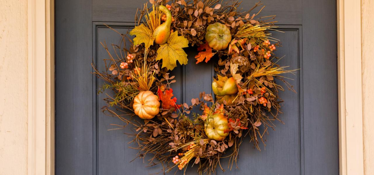 autumn wreath on front door of house
