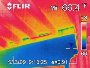 Infrared image showing heat loss through wall cavities