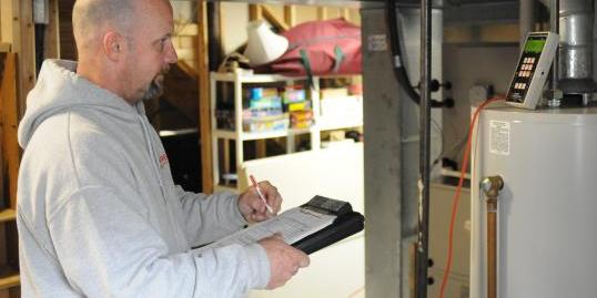 A man doing a safety check for Assured Energy Solutions, LLC.